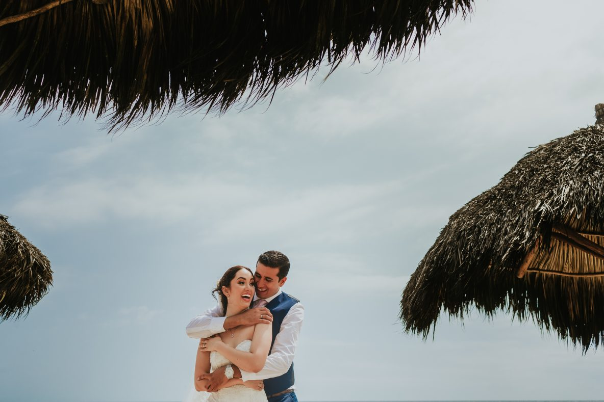 wedding-paertovallarta-hug-groom-bride-smile-sky-moment