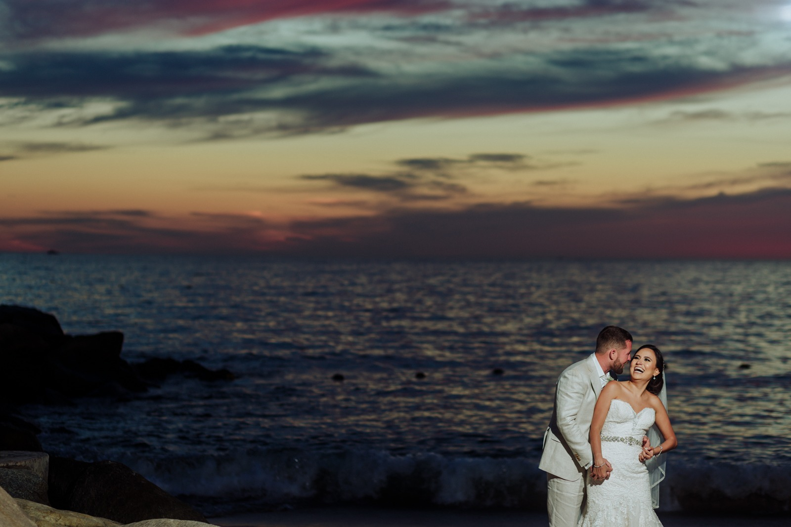 bride-groom-sunset-smile-ocean-sky-beach-moment-wedding