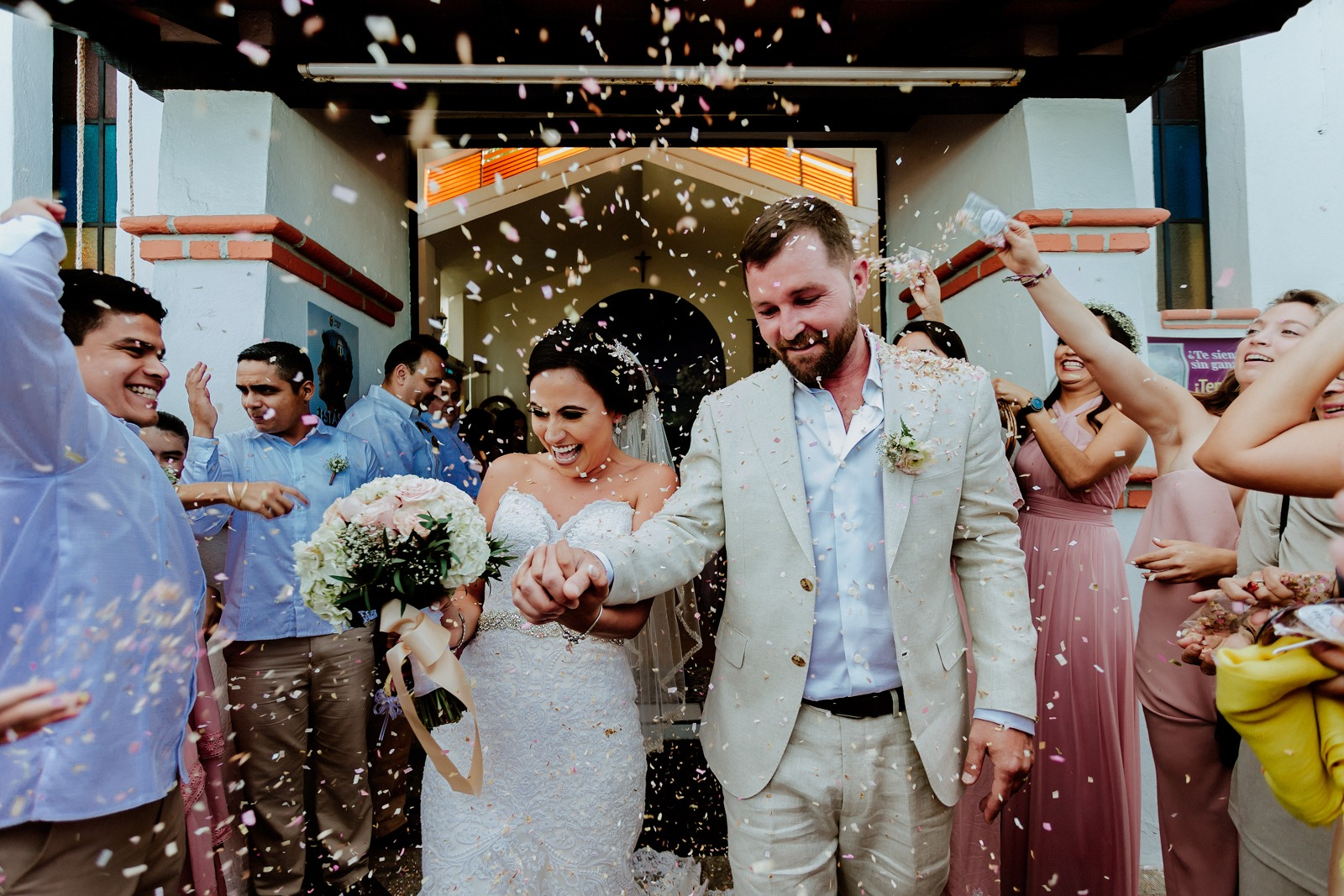 ceremony-confetti-bride-groom-church-friends-smile-flowers