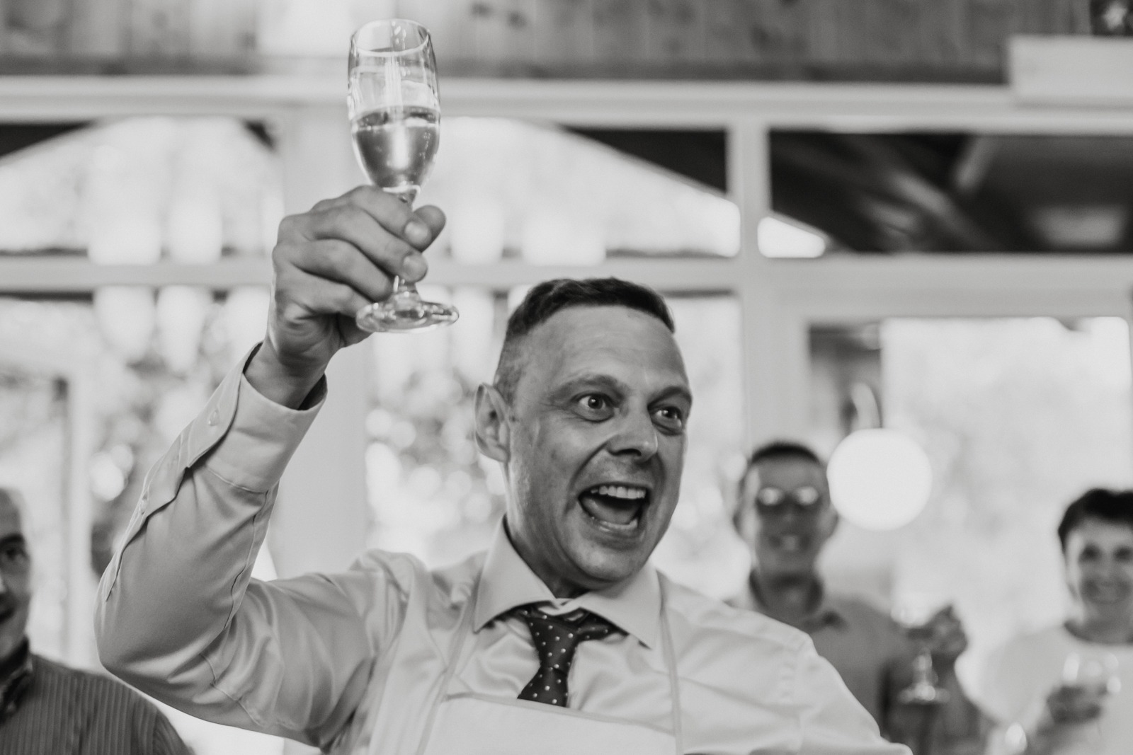 groom-smile-toast-wedding-italy-party-fun-drink-glass